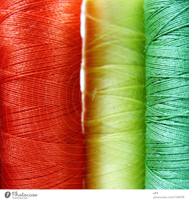 motley String Sewing Sewing machine Multicoloured Green Yellow Red Coil Wrapped around Wound up Process Thin Fine Long Pattern Crossed Clothing Stitching