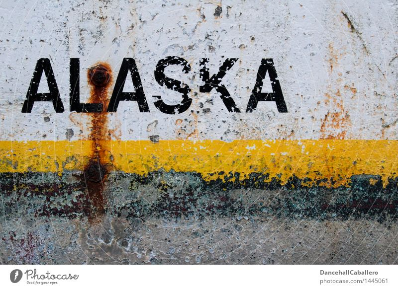 Alaska Vacation & Travel Tourism Metal Steel Rust Characters Graffiti Stripe Old Dirty Broken Trashy Town Yellow Black White Art Decline Varnish Flake off