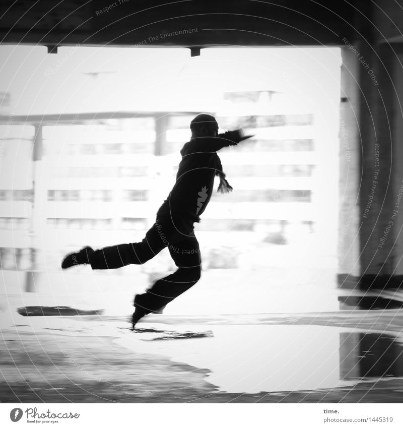 Flyin' Jo Masculine 1 Human being Water Puddle High-rise Wall (barrier) Wall (building) Facade Column Flying Walking Jump Dance Romp Athletic Town Joy Euphoria