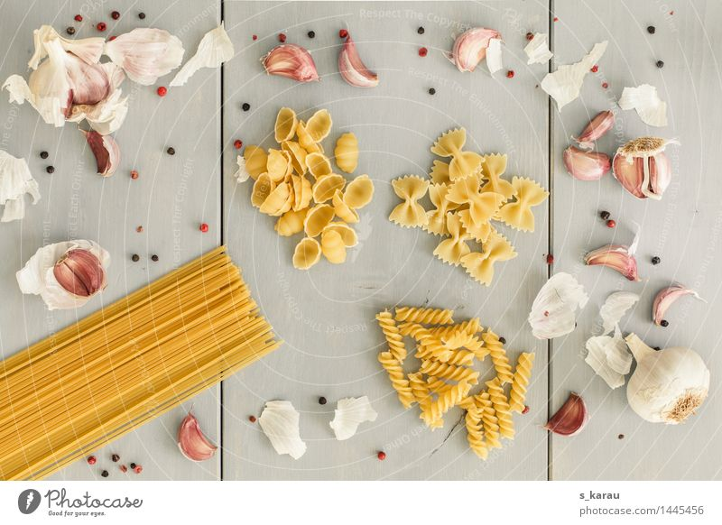 pasta Food Noodles Nutrition Lunch Dinner Yellow Gray To enjoy Farfalle Garlic Clove of garlic Eating Pepper Spaghetti Herbs and spices Cooking Colour photo