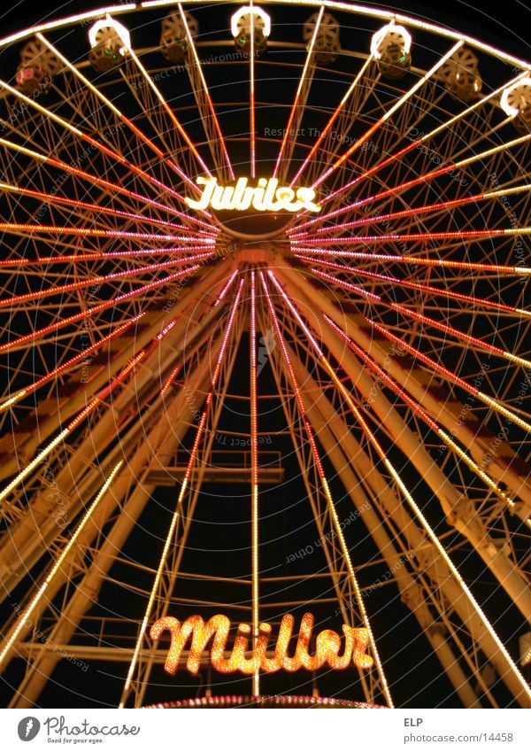 Ferris wheel Fairs & Carnivals Night Showman Leisure and hobbies Light Joy travelling people Tall