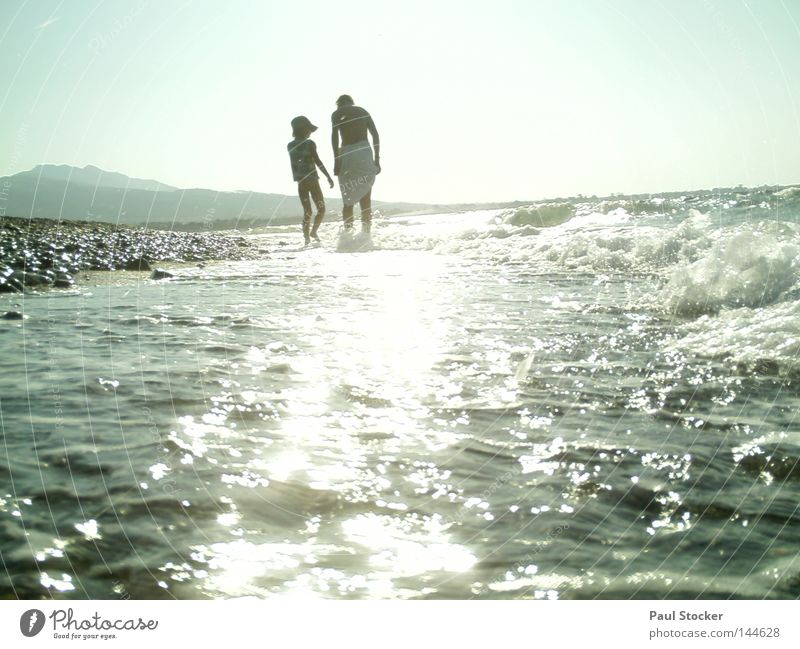 ocean Ocean Kos Greece Human being Water Sun Waves Beach Lake River Drops of water Girl Woman Mother Child Happiness Summer Swimming & Bathing Light Coast Stone