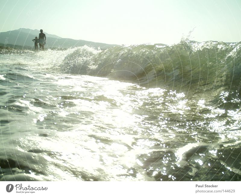 shaft Ocean Water Waves Sun Light Human being Greece Kos Beach Lake River Drops of water Girl Woman Mother Child Happiness Summer Coast Swimming & Bathing