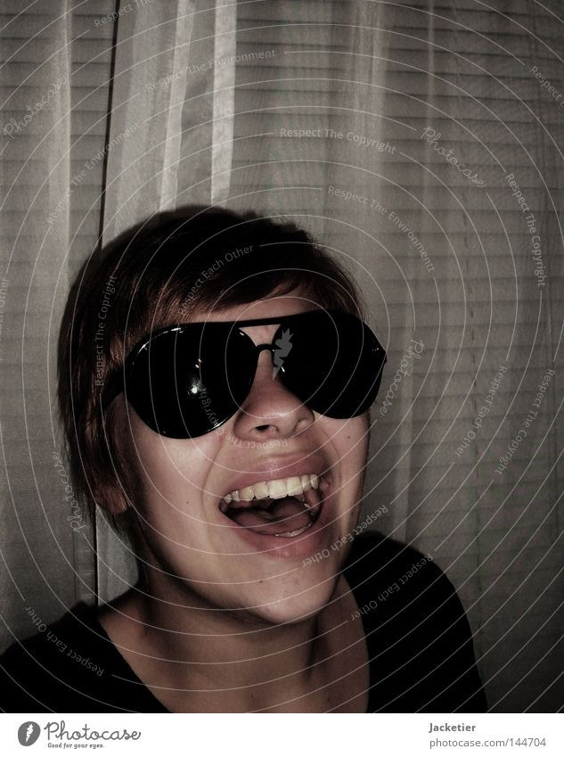 The last one to laugh... Drape Venetian blinds Woman Young lady Cheek Chin Emotions sunglasses Laughter Hair and hairstyles Neck Tongue Teeth