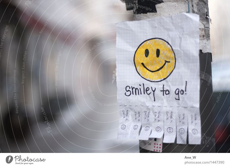 Take a smile 2 Joy Reading Street Piece of paper Lamp post Select Utilize Discover Smiling Laughter Walking Illuminate Fantastic Happiness Happy Funny Positive