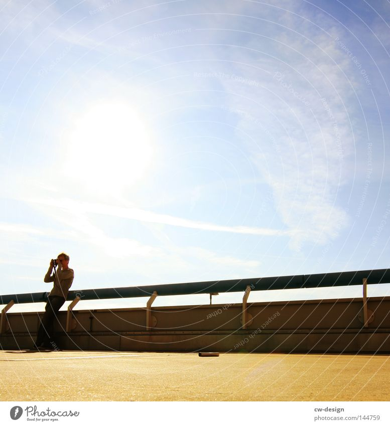 Human being Man Blue Sun Calm Far-off places Cold Stone Lamp Bright Line Leisure and hobbies Sit Wait Concrete Arrangement