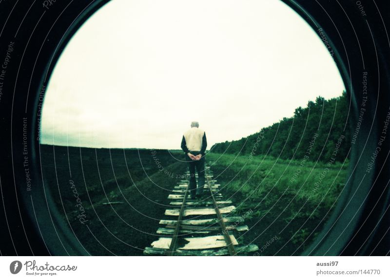 Loneliness Senior citizen Going Railroad Round To go for a walk Logistics Railroad tracks Human being Fisheye Lomography Pedestrian Railroad tie