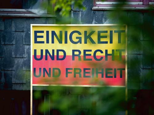 I wish I were. Tree Leaf Germany Facade Sign Characters Signs and labeling Ensign Exceptional Historic Rebellious Town Yellow Red Black Enthusiasm Trust Hope