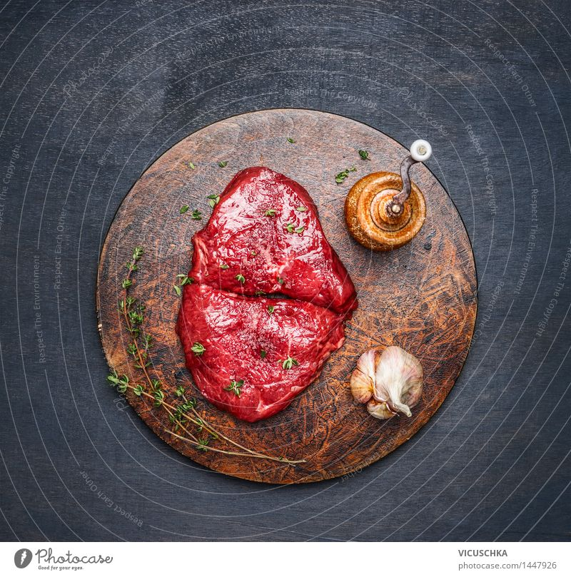 Steaks with ingredients on a round chopping board Food Meat Herbs and spices Nutrition Lunch Dinner Organic produce Diet Healthy Eating Table Kitchen Design