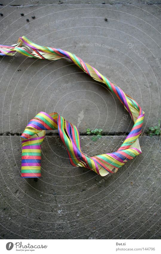 hangover Experimental Blow Paper streamers Paper chain Party Moody Multicoloured Stripe Bend Complicated Muddled Sidewalk Seam Furrow Remainder Trash Dispose of