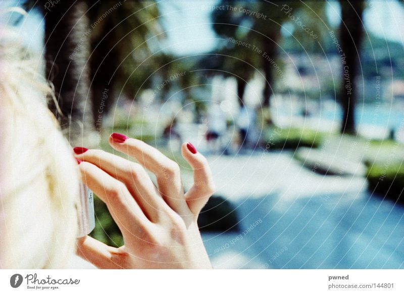 the fingers! Fingers Nail polish Vacation & Travel Take a photo Depth of field Palm tree Water Woman Red Blonde Joy Summer