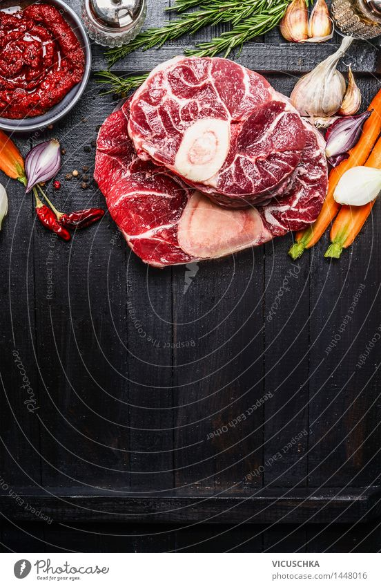 Knuckle of veal slices of meat and ingredients for Osso Buco cooking Food Meat Vegetable Herbs and spices Nutrition Lunch Dinner Buffet Brunch Organic produce