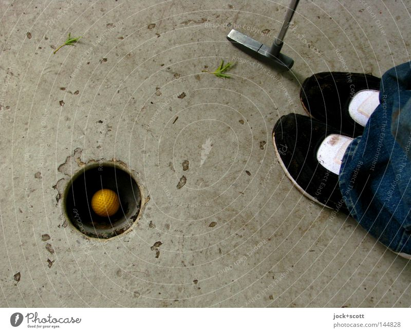 to putt Leisure and hobbies Mini golf Success Golf Ball Footwear Concrete Sphere Playing Stand Authentic Emotions Happy Contentment Experience Target Hole