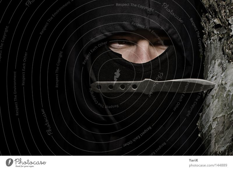 on the lurking, on the... Ninja Mercenary Man Wrap up warm Camouflage Hooded (clothing) Black Dark Film industry Japan Asia Looking Green Brown Dangerous Evil