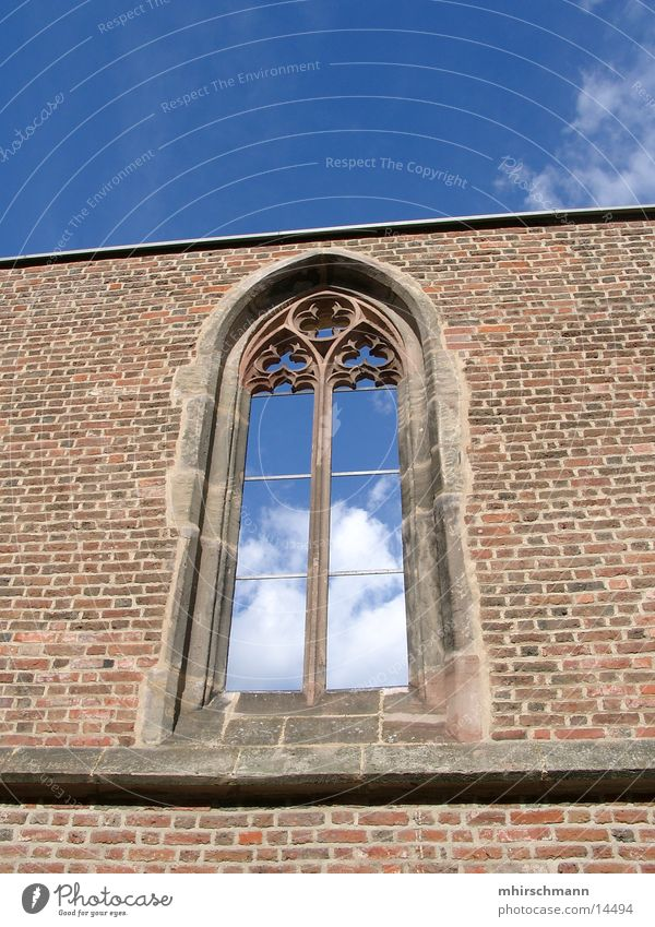 Sky Blue Clouds Window Stone Wall (barrier) Religion and faith House of worship Vaulting Church window