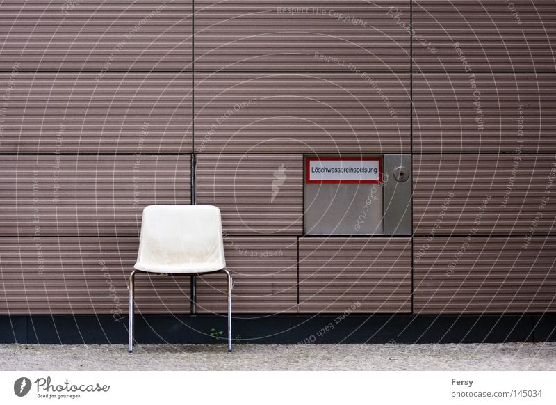 your place Chair Abstract Wall (building) Extinguisher Signage street Wall (barrier)