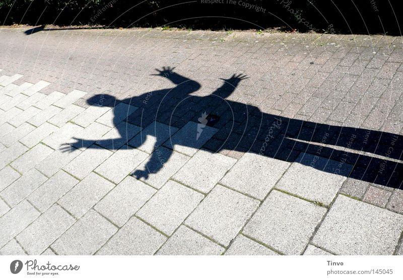 Human being Hand Joy Black Street Playing Gray Stone Legs Arm Lie Fingers Ground Long Sidewalk Seam
