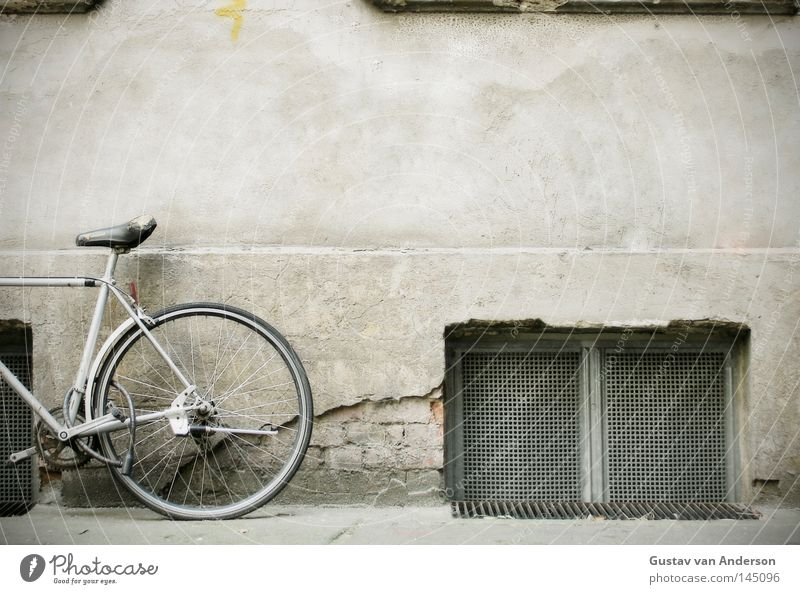 stand wheel Bicycle Wall (building) Window Cellar Cellar window Grating Plaster Facade Iron Framework Photography Backyard Things Seating Partially visible