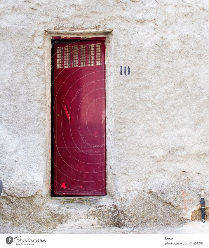 It's outside the door. House (Residential Structure) Building Red 10 Entrance Gate Digits and numbers Italy Door
