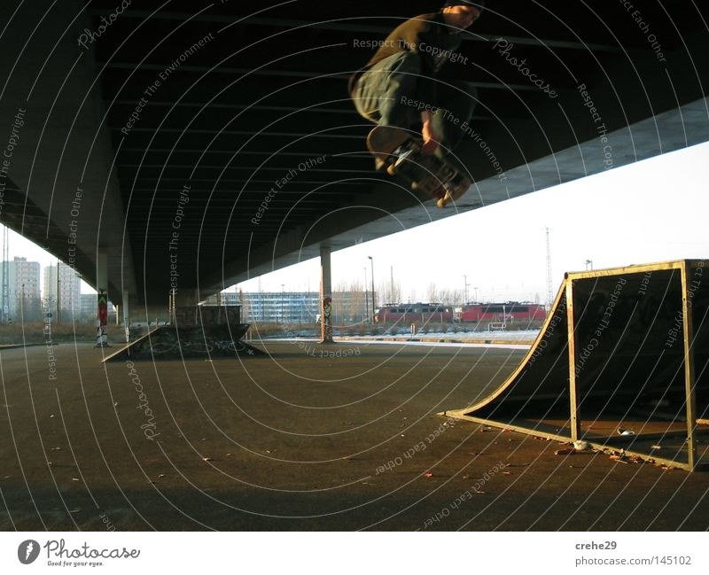 In The Ghetto Street art Bridge Skateboard Skateboarding Town Jump Light Shadow Looking Joy Leisure and hobbies