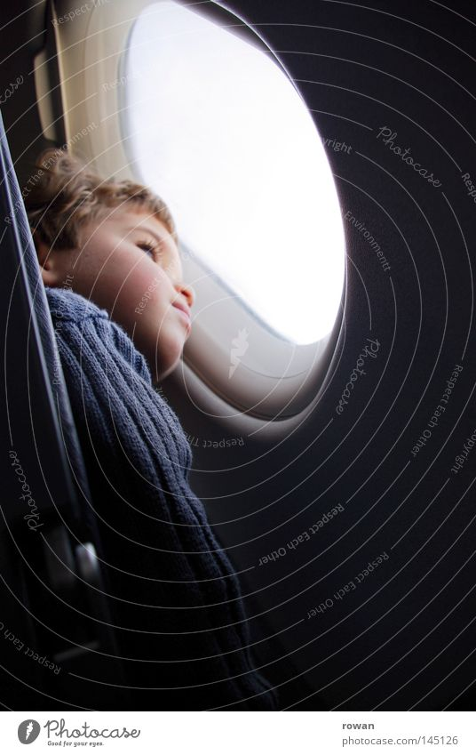 Child Sky Vacation & Travel Loneliness Far-off places Boy (child) Window Dream Think Airplane Flying Tall Aviation Vantage point Infancy Wanderlust