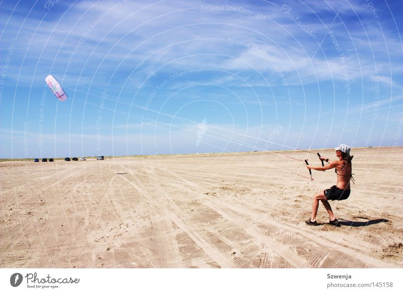 steadfast Colour photo Exterior shot Day Far-off places Summer Beach Woman Adults Clouds Wind To hold on Flying Romp Strong Blue Rømø Sky blue Funsport Dragon