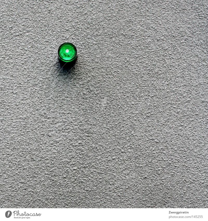 Small green alarm light... Alarm Alarm system Light Lamp Green Signal Wall (building) Plaster Gray Gloomy Exterior shot Minimalistic Warning signal