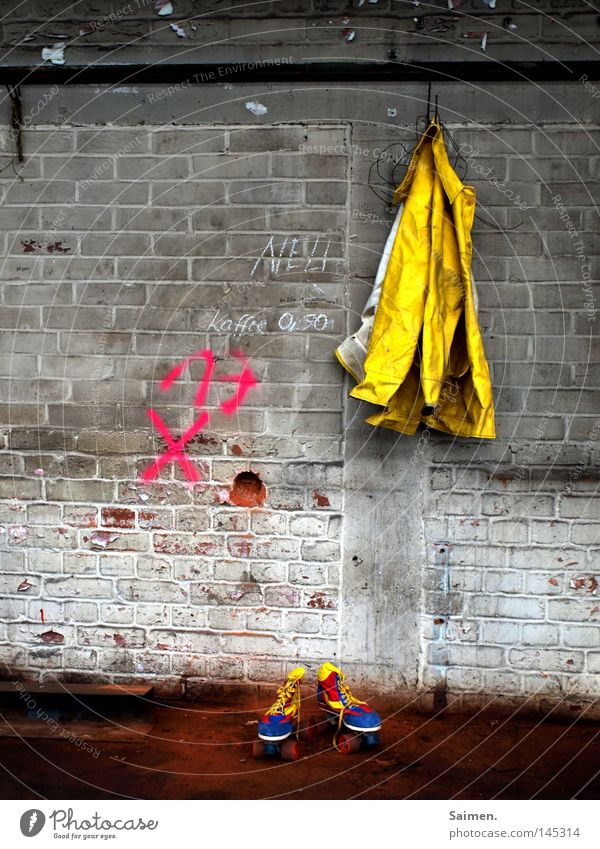 joy and sorrow Raincoat Roller skates Dirty Stone Warehouse Hall Shabby Contrast Converse Cold Wet Multicoloured Yellow Red Blue Wall (building) Ground Hang up