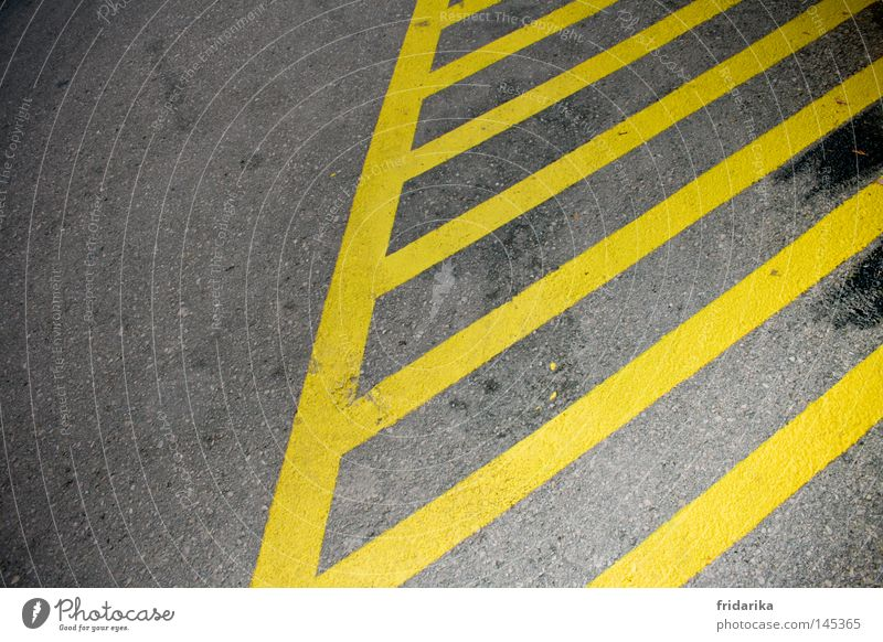 streaked Transport Traffic infrastructure Street Lanes & trails Stripe Yellow Gray Across Diagonal Stop (public transport) Colour photo Exterior shot