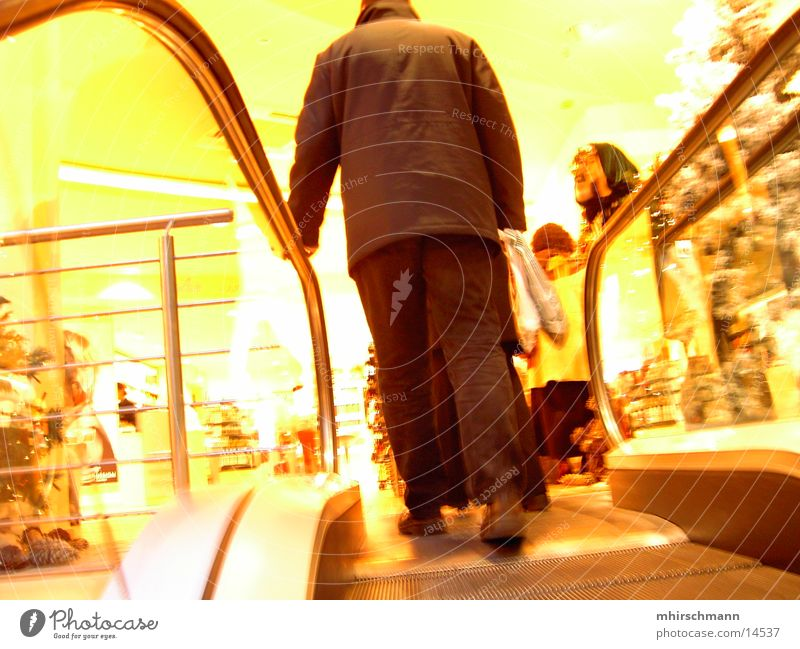 Human being Christmas & Advent Yellow Movement Going Shopping Store premises Merchant Escalator Douglas