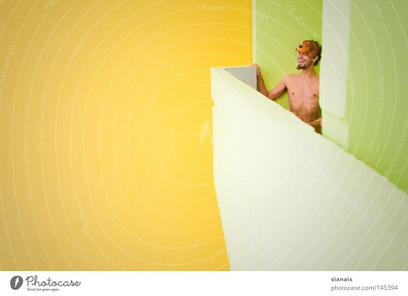Man Youth (Young adults) Green Joy Yellow Naked Laughter Bright Architecture Funny Small Concrete Perspective Empty Mask Carnival