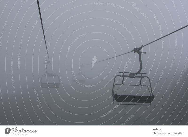 Chairlift ride in the fog Calm Trip Mountain Hiking Chair lift Nature Drops of water Sky Autumn Weather Bad weather Fog Cable car Creepy Cold Gray Dreary Damp