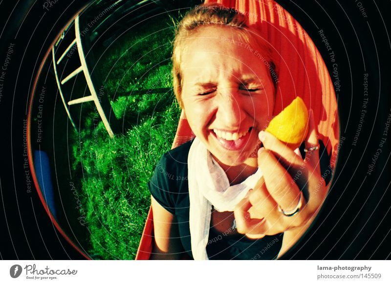 SOUR MAKES FUN Lemon Vitamin C Crazy Action Absurdity Woman Youth (Young adults) Grimace Distorted Hammock Summer Sun Open-air swimming pool Meadow Fisheye
