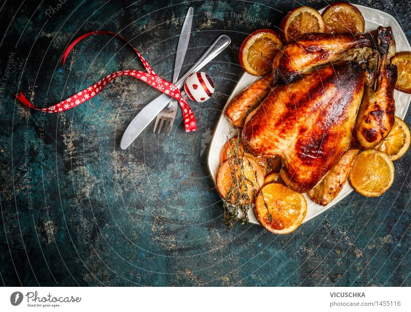 Roasted chicken with oranges for Christmas table Food Meat Orange Herbs and spices Nutrition Dinner Banquet Business lunch Organic produce Plate Fork Spoon