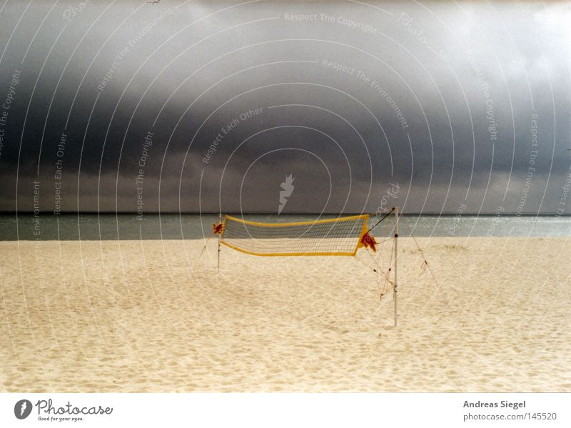 Playing on the beach Beach Ocean North Sea Volleyball (sport) Net Playing field Weather Clouds Gray Rain Storm Sports Sand Loneliness Dark Apocalypse