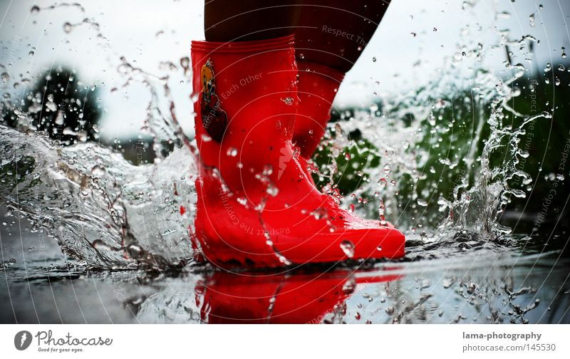 autumn stories Rubber boots Boots Puddle Inject Drops of water Rain Storm Wet Effervescent Rainwater Dirty Autumn Moody Pink Red Jump Hop Playing Reflection Mud