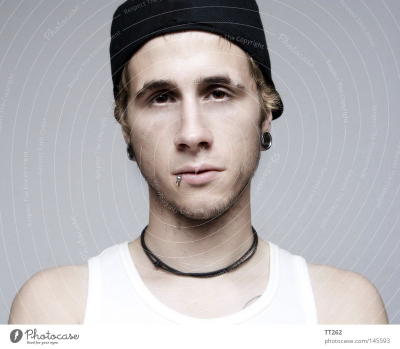 Human being Man Portrait photograph Gloomy Tunnel Boredom Piercing Headwear Lip piercing Baseball cap