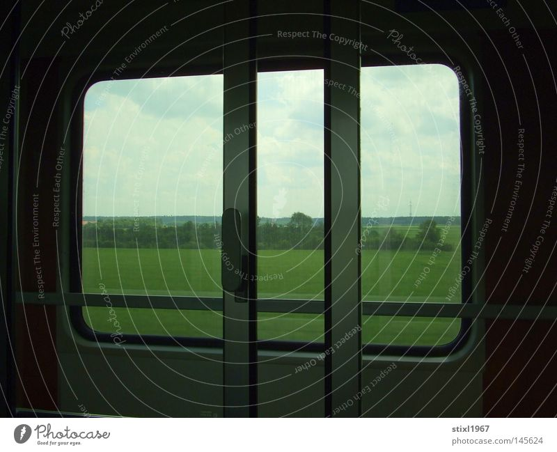 rail Railroad Window Sliding door Car door Looking Land Feature Lawn Meadow Tree Bushes Green Vacation & Travel Travel photography Sky Clouds Blue White