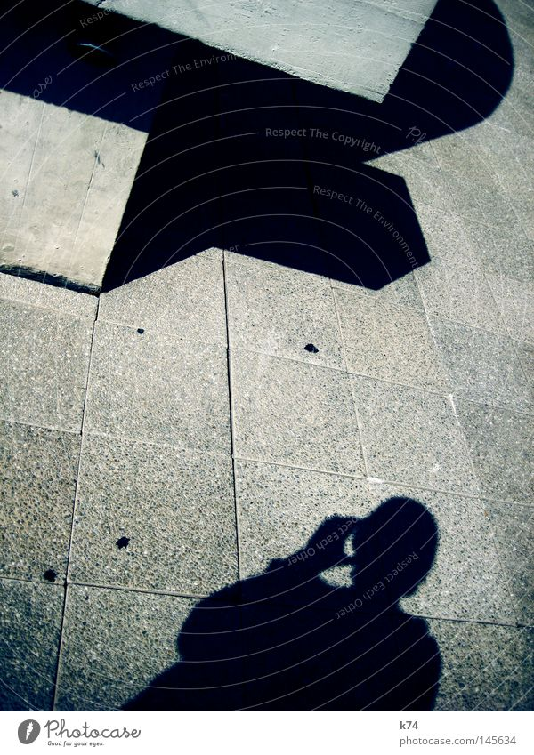 shadows of ourselves Independence Shadow Human being Man Concrete Structures and shapes Square Cubism Drinking Head Hand Shoulder Silhouette Looking Discover