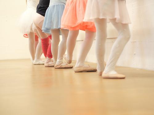 on your knees Dance Child Study Human being Feminine Girl Infancy Legs 6 Group of children 3 - 8 years Art Dance event Dancer Music Listen to music Stage Skirt