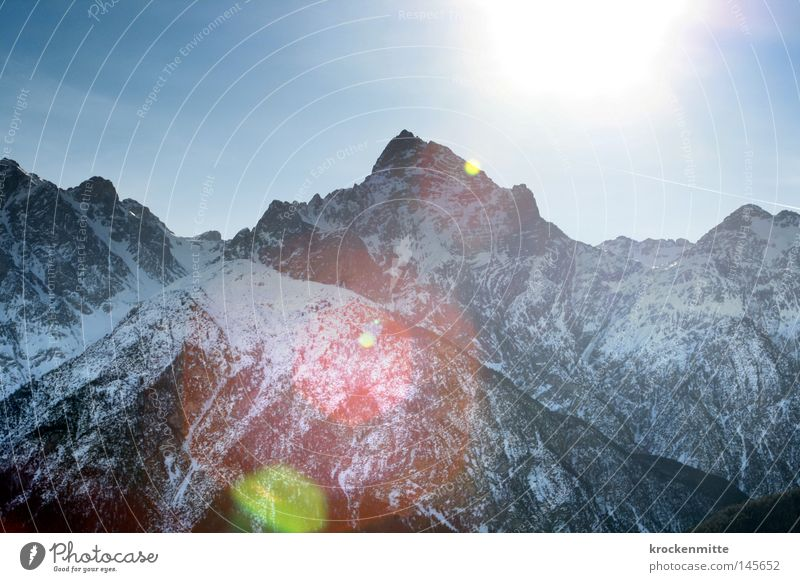 Nature Winter Snow Mountain Stone Lighting Point Switzerland Top Height Ski resort Mountain range Lens flare Massive Alpine Comb