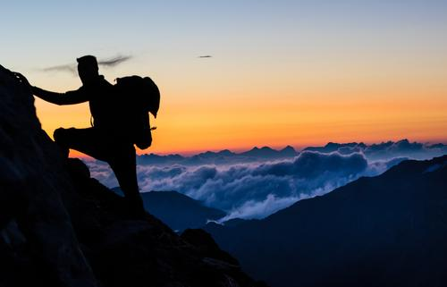 Climber at the top of the mountain in the morning Athletic Fitness Tourism Adventure Freedom Expedition Mountain Hiking Climbing Mountaineering Masculine 1