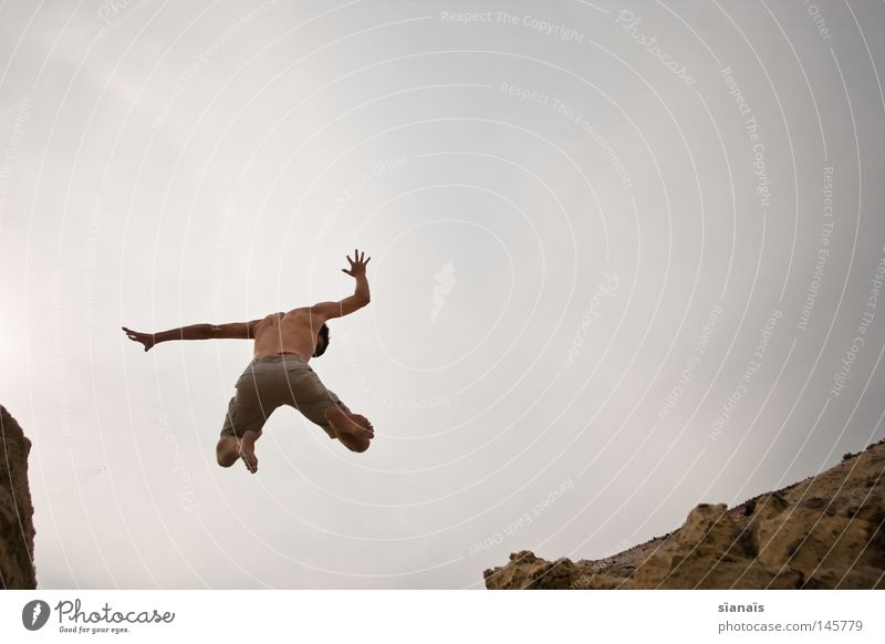 Sky Man Nature Youth (Young adults) Summer Joy Movement Freedom Gray Happy Sand Stone Jump Earth Feet Earth