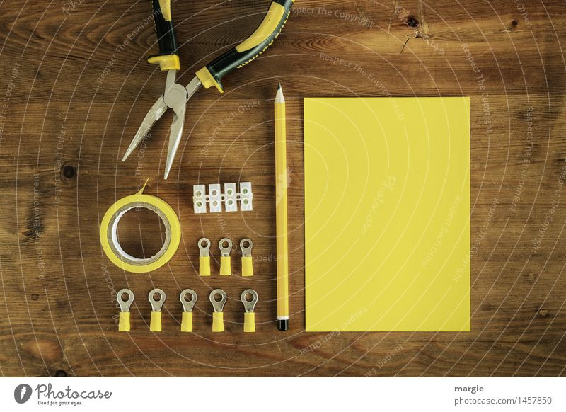 Yellow current: yellow writing paper with pencil and electrical utensils such as insulating tape, lyster clamps and pliers Work and employment Profession