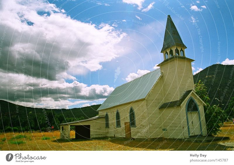 Not without a garage. Religion and faith Church House of worship Garage White Tower Church spire Bell tower Wide angle Clouds Sun Structures and shapes