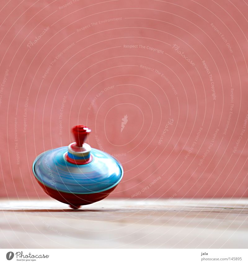 colors in motion Leisure and hobbies Playing Dance Toys Kitsch Odds and ends Movement Rotate Speed Pink Red Colour Rotation Gyroscope Colour photo Exterior shot