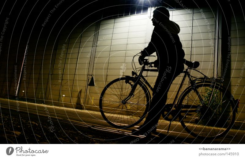 Man Street Dark Cold Wall (building) Lamp Bicycle Leisure and hobbies Wait Sit Driving Industrial Photography Jacket Frame Guy Spokes