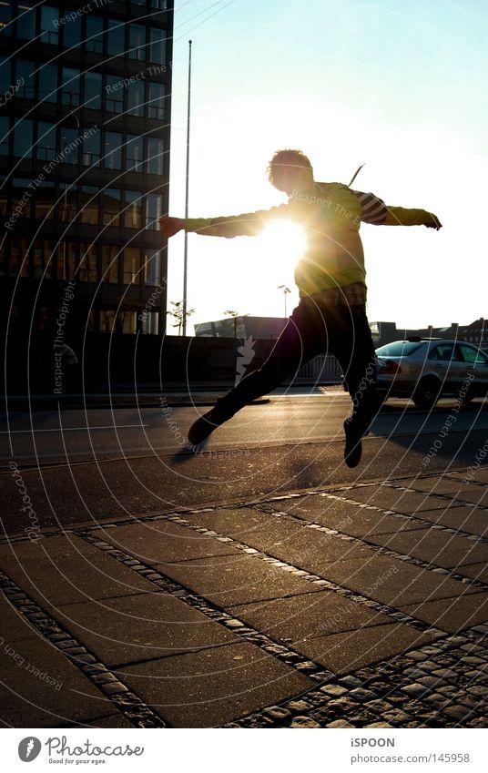 jumping spoon Man Jump Legs Feet Ground Paving tiles Street Cycle path High-rise Sunset Town Copenhagen Denmark Bridge Evening Tall Sky Blue Yellow Black Orange