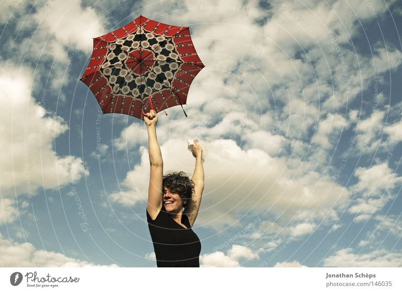 young woman with red umbrella stretches her arms in the blue sky for joy Joy luck Hair and hairstyles Contentment Far-off places Success Youth (Young adults)
