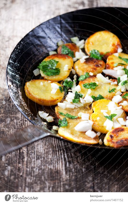 Fried potatoes in an iron pan Vegetable Herbs and spices Wood Fresh Cheap Good Potatoes Roasted Crisps Potato dish potato side dish Side dish Onion onion cubes